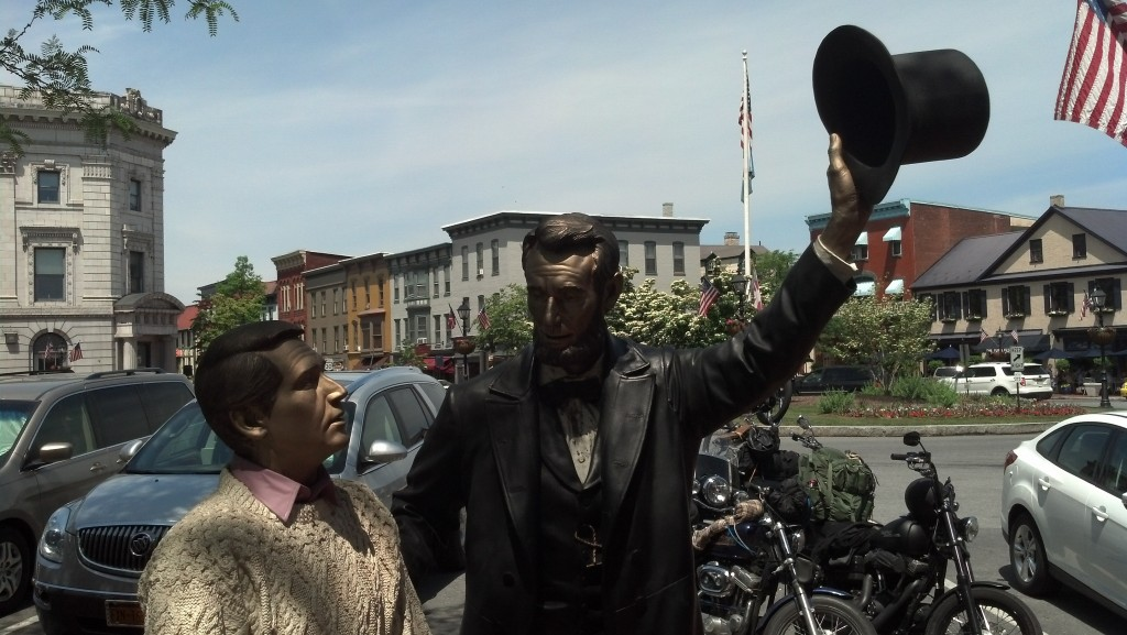 A statue of Abraham Lincoln greets visitors -- and in this case a statue of a visitor to Gettysburg -- in the center of town, outside the Wills House. (Photo by Michael E. Grass)