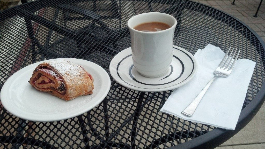 I enjoyed a raspberry Hungarian tea cake and Black Tulip coffee on the sidewalk from the Tulipán Hungarian Pastry and Coffee Shop  in Wooster, Ohio. (Photo by Michael E. Grass)