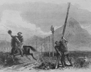 A Pony Express rider salutes men stringing telegraph wire in Utah in an 1867 wood engraving adapted from a painting by George M. Ottinger. (Print via the Library of Congress Prints and Photographs Division >>)